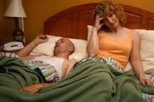 This picture is a man and woman suffering insomnia